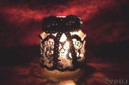 Lanterna com recipiente de vidro usado com renda