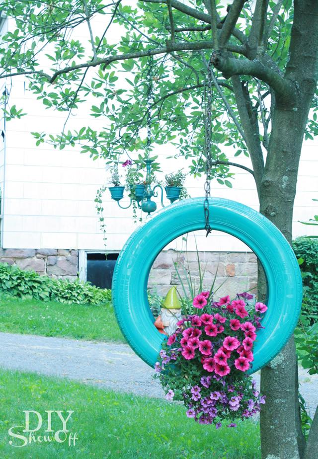 Vaso de flores de pneu pendurado