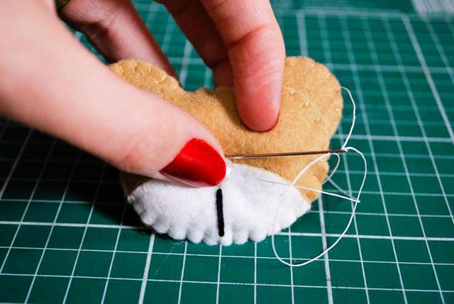 Costure o nariz com linha de pipa