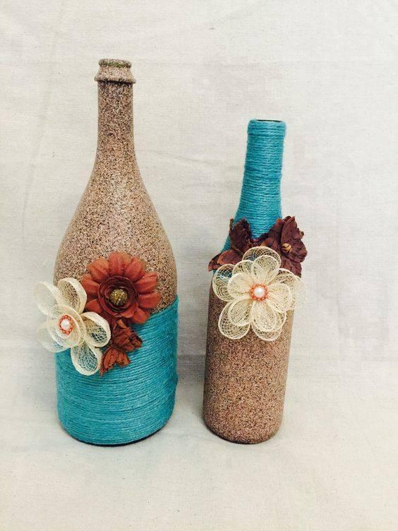 garrafa decorada com areia e lã azul