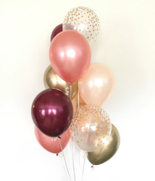 Balões em tons de rosa e dourado