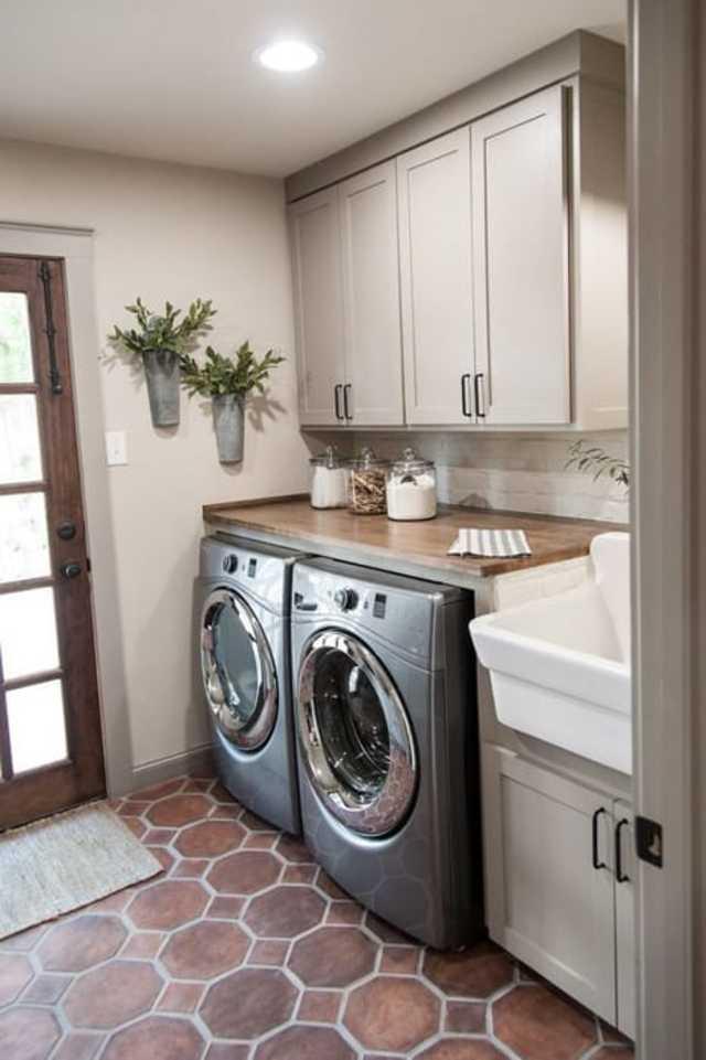 Lavanderia com capacho na porta