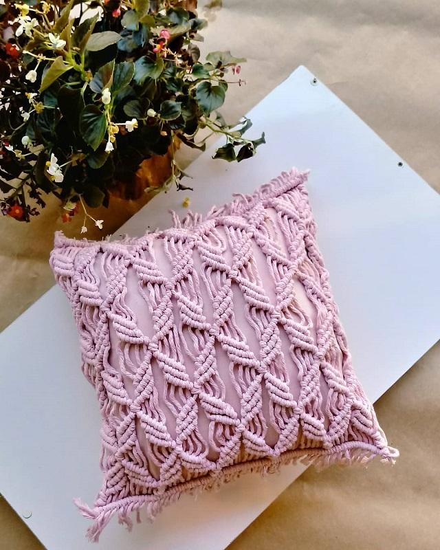 Capa de almofada de macramê rosa