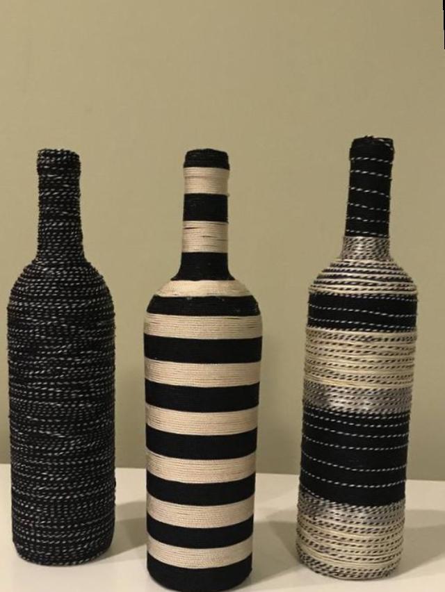 Garrafas decoradas com barbante preto e prata