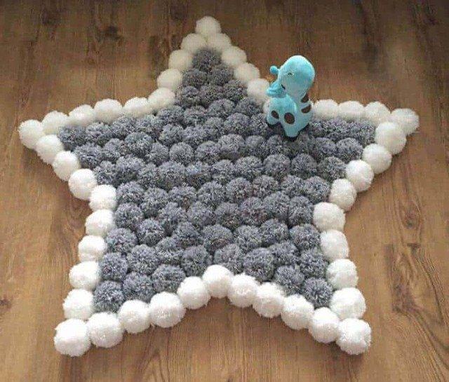 Tapete de pompom em formato de estrela