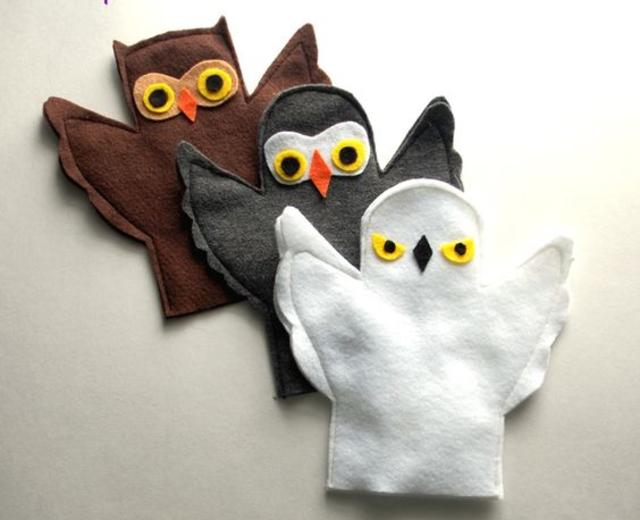 Fantoches de corujas de feltro